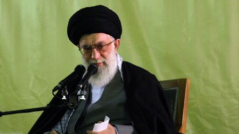 """Iran's Supreme leader Ayatollah Ali Khamenei delivers a speech under a portrait of Iran's late founder of the Islamic Republic, Ayatollah Ruhollah Khomeini, at the shrine of Imam Reza in the city of Mashhad, northeast of Iran, on March 21, 2010. Khamenei in his new year address to the nation accused the US president of plotting against Iran as crowds of worshippers shouted """"Death to Obama"""". AFP PHOTO/FARS NEWS/MAYSAM DEHGHANI (Photo credit should read MAYSAM DEHGHANI/AFP/Getty Images)"""