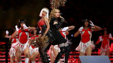 """Nicki Minaj and M.I.A. (not pictured) join Madonna on stage dressed as cheerleaders. The pair are featured on """"Give Me All Your Luvin,"""" the first single on Madonna's forthcoming """"M.D.N.A."""" It's due out in March."""
