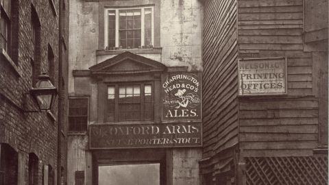 """The Oxford Arms inn, demolished in 1876, was typical of the """"ancient hostelries"""" that had """"degenerated into little more than the abiding and booking-places of country wagons,"""" according to Dickens."""