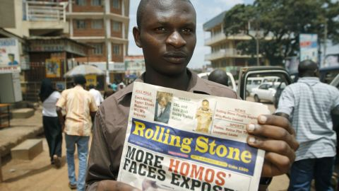 Giles Muhame, managing editor of the Ugandan publication 'Rolling Stone', holds the latest issue of his newspaper on the streets of Kampala, November 3, 2010.