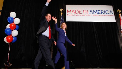 GOP presidential candidate Rick Santorum was joined by his wife after being projected the winner in two of Tuesday night's contests.