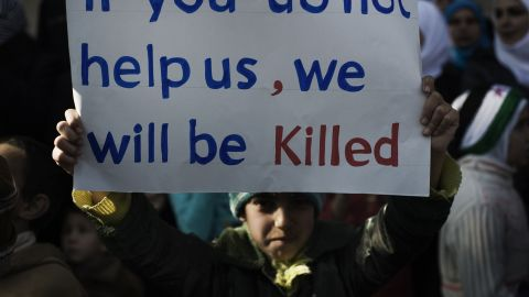 A young boy holds up a sign during an anti-regime demonstration in the Syrian village of al-Qsair, 25 km southwest of the flashpoint city Homs, on February 3, 2012.
