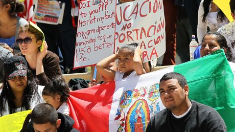 Activists carry signs and flags in protest of Arizona's new immigration law during a rally  April 30, 2010 in Oakland, California.