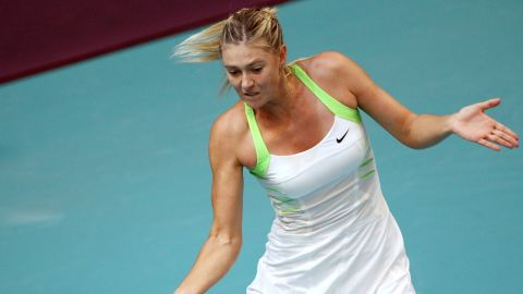 Maria Sharapova plays a return during her straight sets defeat to Angelique Kerber in Paris.