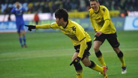 Borussia Dortmund's Shinji Kagawa celebrates scoring the winning goal against Bayer Leverkusen on Saturday.