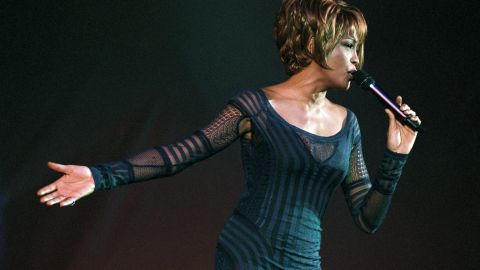 Houston performs during an AmFar Benefit Concert in December 1998.