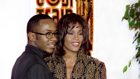 On February 8, 1994, US singer Whitney Houston poses with her husband, Bobby Brown.