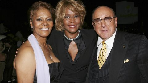 Houston poses with her cousin Dionne Warwick and producer Clive Davis during the 15th annual Ella Awards in September 2006.