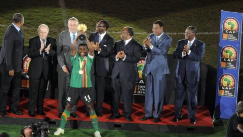 Zambia captain Christopher Katongo holds the Africa Cup of Nations trophy aloft after his team's dramatic penalty shootout victory over Ivory Coast in Libreville, Gabon.