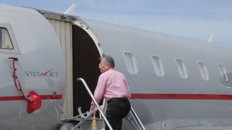 """A visitor to the Singapore Airshow walks up the steps of a Bombardier personal jet. """"The richest are the most casually dressed,"""" observes David Velupillai of Airbus Corporate Jets."""