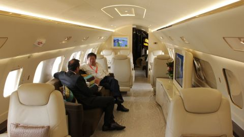 A potential client enjoys the upholstery on board the Embraer Lineage 1000.