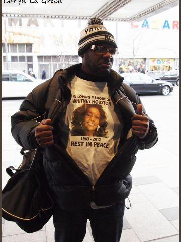 """The day after Houston was found dead at a Beverly Hills hotel, fans left flowers and notes outside New York's Apollo Theater, where she filmed one of her first music videos. One fan wore a T-shirt in her memory. New Jersey photographer <a href=""""http://ireport.cnn.com/docs/DOC-747770"""">Caryn La Greca </a> says she """"felt sorrow for the young singer who lost her life so young."""""""