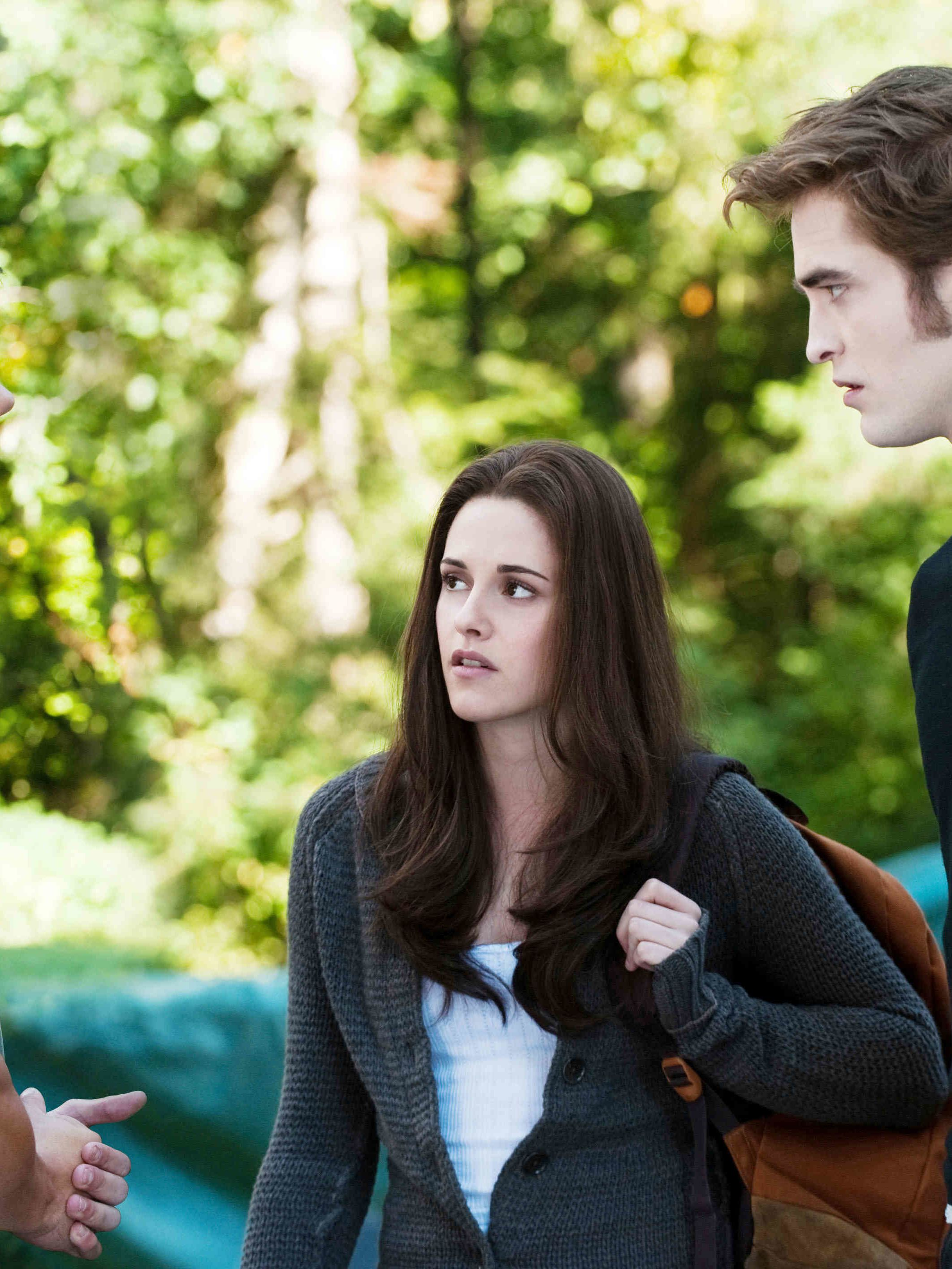 """It's the problem we wish we had in high school: two gorgeous guys fighting for one girl's attention. Young adult books abound with love triangles, and the """"Twilight"""" saga (with, from left, Taylor Lautner, Kristen Stewart and Robert Pattinson in the movie versions) was one of the first to start this ongoing trend."""