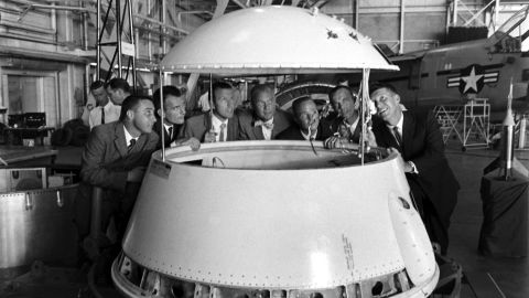 """The original Mercury 7 astronauts inspect an early design of a space module. From left are Gus Grissom, Deke Slayton, Gordon Cooper, John Glenn, Scott Carpenter, Alan Shepard and Wally Schirra. In 1962, Glenn was the first American to orbit the Earth. <a href=""""http://life.time.com/history/john-glenn-unpublished-photos/#1"""" target=""""_blank"""" target=""""_blank"""">See more images at Life.com</a>"""