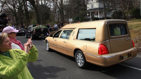 The hearse carrying the body of singer Whitney Houston arrives for her burial service Sunday in Westfield, New Jersey.