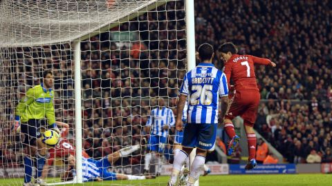 Luis Suarez scores for Liverpool as they thrashed second-tier Brighton 6-1 in the FA Cup.