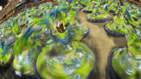 Performers from Portela samba school dance at the Sambadrome in Rio de Janeiro on Sunday, February 19.