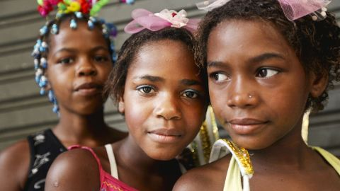 Three girls take a break from the festivities to pose for a photo during carnival celebrations Sunday in Rio de Janeiro.