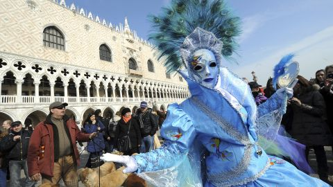 A masked reveler poses on the Piazza San Marco during the carnival in Venice, Italy, on Saturday, February 18.
