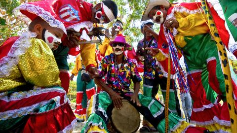 Performers play music before a carnival parade in Barranquilla on Sunday.