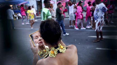 A Brazilian reveler dons makeup during carnival celebrations in Rio de Janeiro on Monday, February 20.