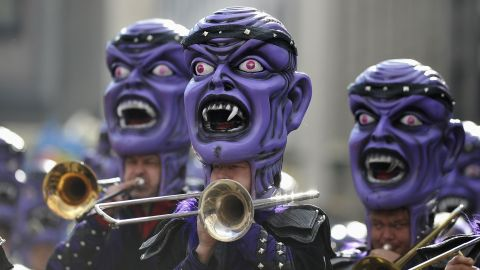Carnival revelers accompany a float in the Rose Monday parade  in Cologne, Germany.