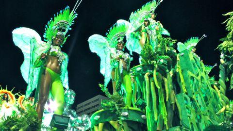 Revelers on a float  enjoy the parade as Rio de Janeiro's carnival kicks off Sunday at the Sambadrome.