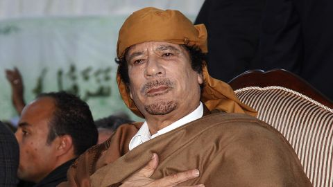 Libyan leader Moamer Kadhafi gestures at supporters in Tripoli on February 13, 2011.