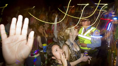 """This lively Mardi Gras scene depicts what many think of when they hear """"New Orleans."""" Chaos and alcohol define the mood, with police standing by."""