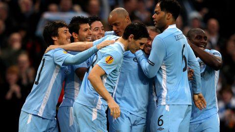 Manchester City players celebrate Sergio Aguero's opener in the 4-0 win over Porto at the Etihad Stadium