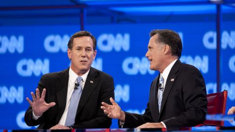 Rick Santorum and Mitt Romney spar during the CNN GOP debate in Arizona.