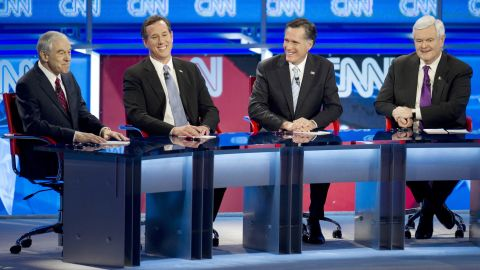 Ron Paul (from left), Rick Santorum,  Mitt Romney  and Newt Gingrich are seated during their February 22 debate in Mesa, Arizona.