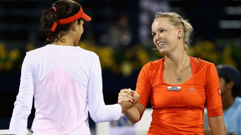 Caroline Wozniacki shakes hands with Ana Ivanovic after their quarterfinal match in Dubai.