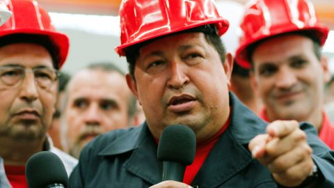 """Handout picture released by the Venezuelan presidency press office showing Venezuelan President Hugo Chavez (R) during an inspection at the Santa Ines agroindustrial complex, in Barinas, on February 21, 2012. Venezuelan President Hugo Chavez announced on Tuesday that in the coming days should be operated to remove a """"lesion"""" in the same place where he was removed a cancerous tumor that was detected in 2011 during some tests in Cuba, but denied to have metastases. AFP PHOTO/PRESIDENCIA RESTRICTED TO EDITORIAL USE - MANDATORY CREDIT """"AFP PHOTO/PRESIDENCIA"""" - NO MARKETING NO ADVERTISING CAMPAIGNS - DISTRIBUTED AS A SERVICE TO CLIENTS (Photo credit should read PRESIDENCIA/AFP/Getty Images)"""