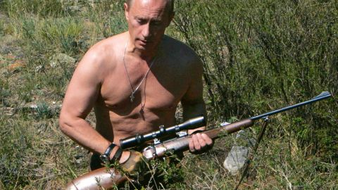 Putin carries a hunting rifle in the Republic of Tuva on September 3, 2007.