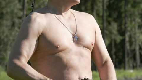 A shirtless Putin fishing in the headwaters of the Yenisei River in the Republic of Tuva on August 13, 2007.