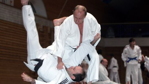 Famed for his love of martial arts, Putin throws a competitor in a judo session at an athletics school in St. Petersburg on December 18, 2009.