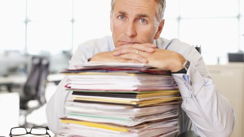 An office worker with a stack of papers.