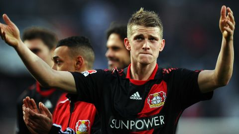 Bayer Leverkusen's two-goal hero Lars Bender celebrates after Saturday's win over Cologne.
