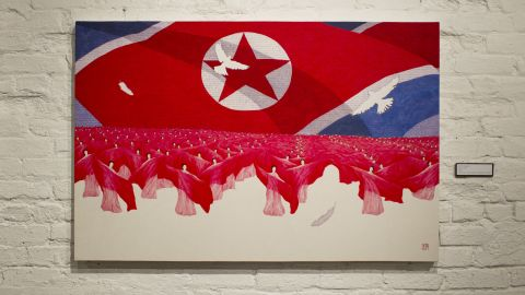 """""""Mass Game"""" depicts a trademark image of North Korea, where thousands participate in exercises of unity and patriotism."""