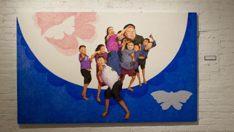 """It's not uncommon for North Koreans to describe the Dear Leader as a surrogate parent. In """"A Loving Father and His Children,"""" Song replaces the chubby, square-jawed children he painted as a propagandist with realistic images of child beggars found around many North Korean rail stations. Passers-by will sometimes pay them to sing; a popular song is """"Our General is a Great Leader."""""""