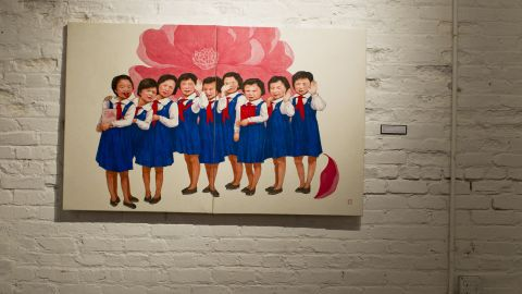 """The girls in """"Flower Children"""" are waving and posing for foreigners in the way they've been trained: brimming with confidence that they live in the world's greatest country. Song painted them with their eyes closed, blind to the reality of their poverty."""