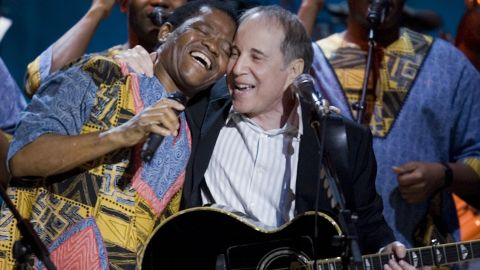 """The band's international breakthrough came in 1986, when American singer Paul Simon (right) featured them on his multi-million selling album"""" Graceland."""