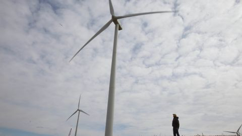 """Tofteland farms 3,000 acres of corn and soybeans. More recently, he's gotten involved in wind farming. """"Look at the curvature of the blades,"""" he says."""