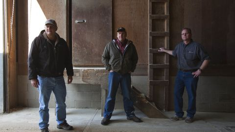 """From left, Brad Mouw, Dean Tofteland and Mike Mouw discuss the MF Global scandal. """"It sucks,"""" Mike Mouw says. He and his brother run Mouw's Feed & Grain in Leota, population 222. They had $450,000 taken."""