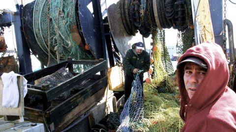 Fishermen work on docks in Gloucester, Massachusetts.