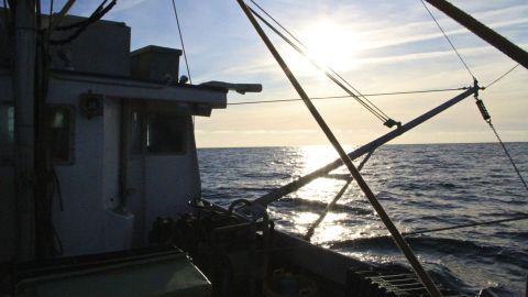 Sunrise aboard a fishing trawler in the Gulf of Maine.