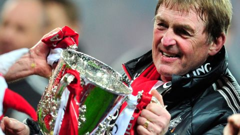 Liverpool manager Kenny Dalglish gets his hands on the English League Cup, the club's first trophy in six seasons. Dalglish's team beat second division Cardiff City in a penalty shootout at Wembley on Sunday.