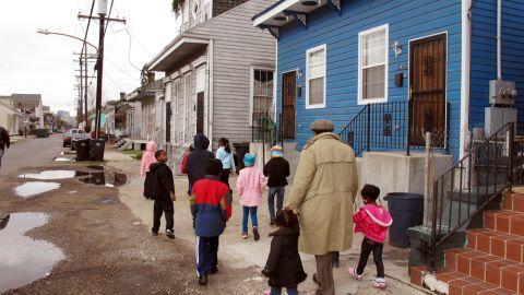 Darryl Durham, head of Anna's Arts for Kids, walks with several children through the Treme neighborhood.