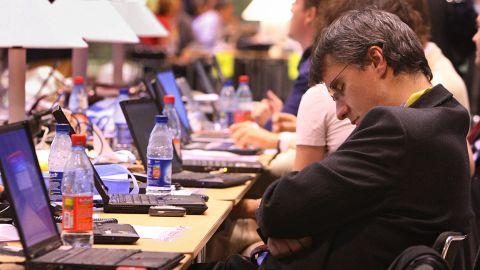 A man sleeps at a European Council meeting in Brussels, Belgium.